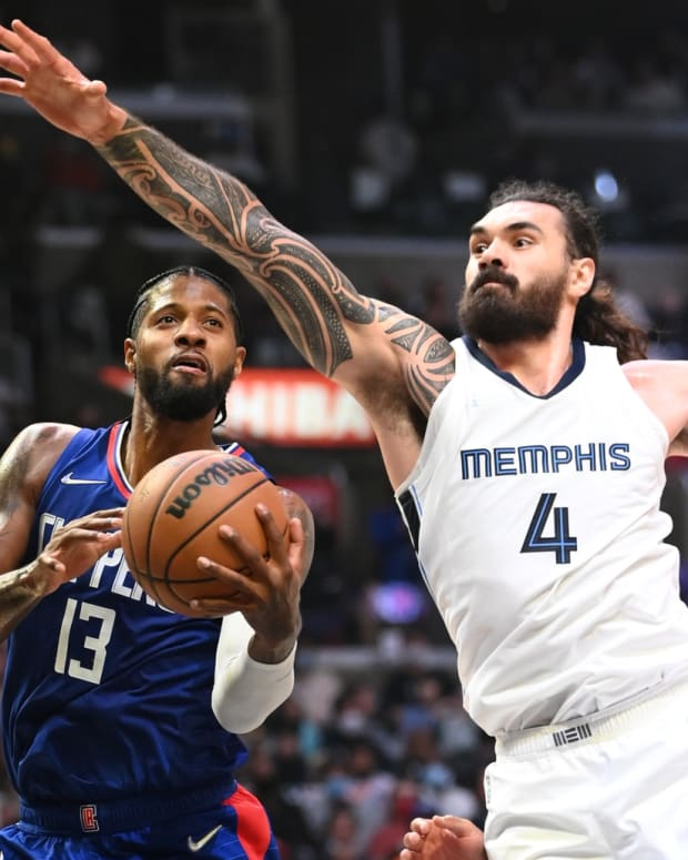 Oct 23, 2021; Los Angeles, California, USA; Memphis Grizzlies center Steven Adams (4) defends a shot by Los Angeles Clippers guard Paul George (13) in the second half at Staples Center. Mandatory Credit: Jayne Kamin-Oncea-USA TODAY Sports