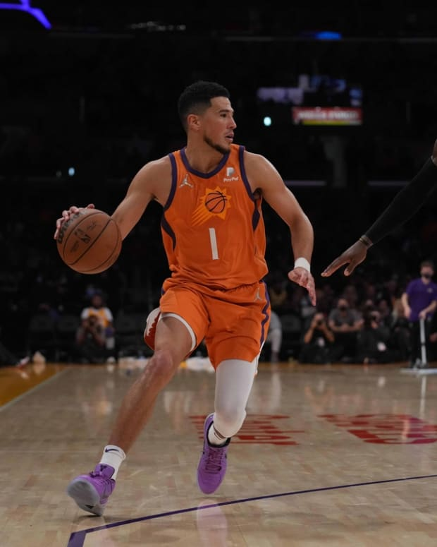 Oct 22, 2021; Los Angeles, California, USA; Phoenix Suns guard Devin Booker (1) is defended by Los Angeles Lakers forward LeBron James (6) in the second half at Staples Center. The Suns defeated the Lakers 115-105. Mandatory Credit: Kirby Lee-USA TODAY Sports