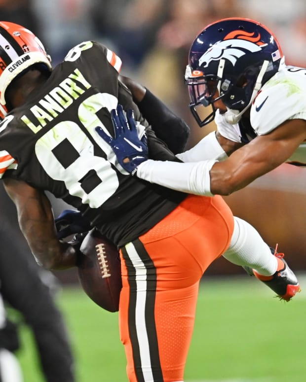 Denver Broncos cornerback Pat Surtain II (2) defends against Cleveland Browns wide receiver Jarvis Landry (80) as Landry goes for a catch during the second half at FirstEnergy Stadium. The play was ruled incomplete.