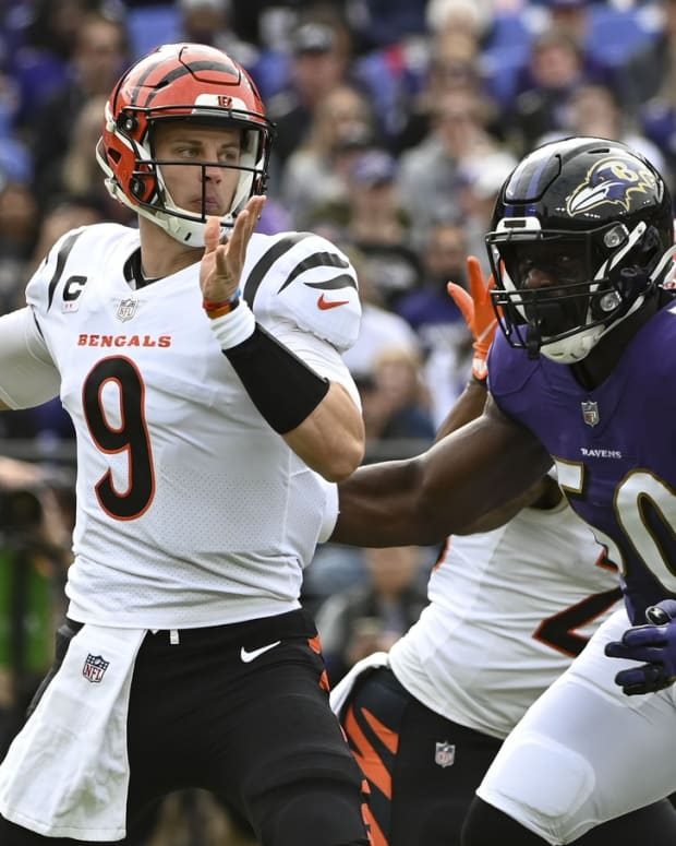 Oct 24, 2021; Baltimore, Maryland, USA; Cincinnati Bengals quarterback Joe Burrow (9) looks to throw as Baltimore Ravens outside linebacker Justin Houston (50) rushes during the first quarter at M&T Bank Stadium. Mandatory Credit: Tommy Gilligan-USA TODAY Sports