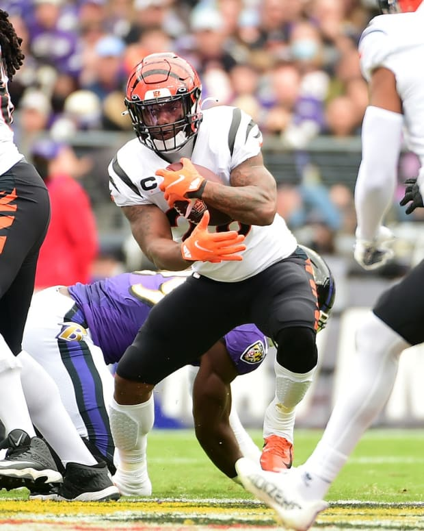 Oct 24, 2021; Baltimore, Maryland, USA; Cincinnati Bengals running back Joe Mixon (28) runs with the ball in the first quarter against the Baltimore Ravens at M&T Bank Stadium. Mandatory Credit: Evan Habeeb-USA TODAY Sports