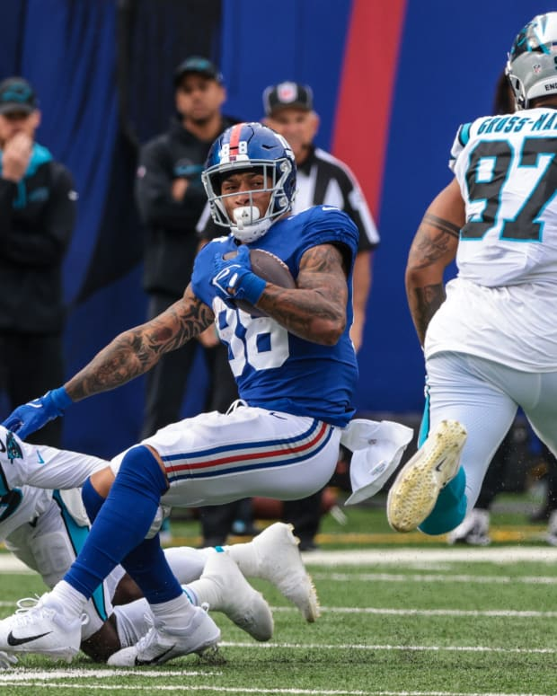 Oct 24, 2021; East Rutherford, New Jersey, USA; New York Giants tight end Evan Engram (88) is tackled by Carolina Panthers cornerback Donte Jackson (26) during the second half at MetLife Stadium.