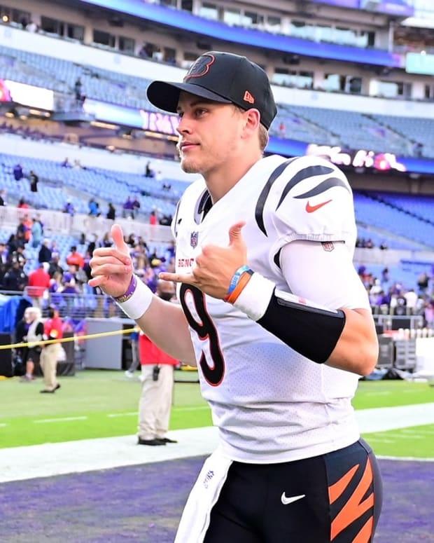Oct 24, 2021; Baltimore, Maryland, USA; Cincinnati Bengals quarterback Joe Burrow (9) signals to fans after beating the Baltimore Ravens 41-17 at M&T Bank Stadium. Mandatory Credit: Evan Habeeb-USA TODAY Sports