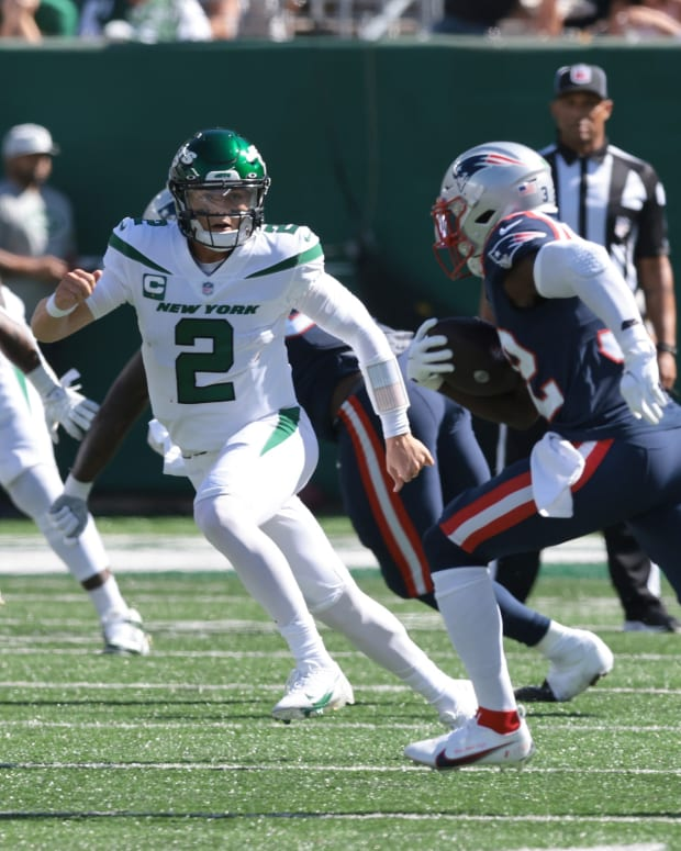 Jets QB Zach Wilson tries to make tackle after throwing interception