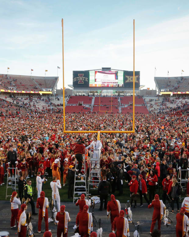 Iowa State fans rush the field after the Cyclones football team beat No. 8-ranked Oklahoma State, 24-21, on Saturday, Oct. 23, 2021, at Jack Trice Stadium in Ames