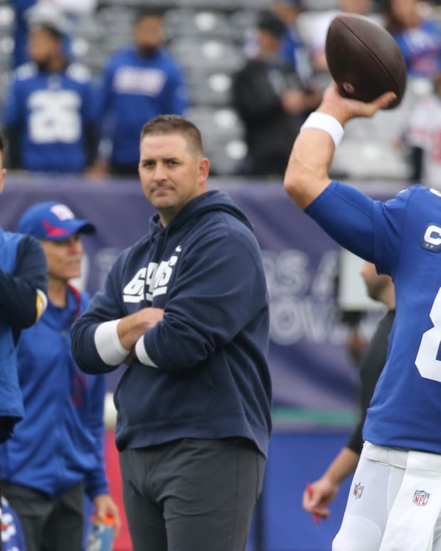 October 24, 2021: Joe Judge watches Daniel Jones warm up before the game against the Carolina Panthers.