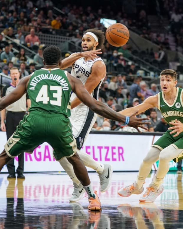 Oct 23, 2021; San Antonio, Texas, USA; San Antonio Spurs guard Derrick White (4) passes the ball in front of Milwaukee Bucks forward Thanasis Antetokounmpo (43) in the second half at the AT&T Center. Mandatory Credit: Daniel Dunn-USA TODAY Sports