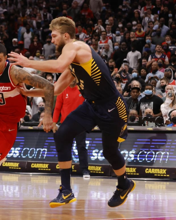 Oct 22, 2021; Washington, District of Columbia, USA; Washington Wizards forward Kyle Kuzma (33) drives to the basket as Indiana Pacers forward Domantas Sabonis (11) during the fourth quarter at Capital One Arena. Mandatory Credit: Geoff Burke-USA TODAY Sports