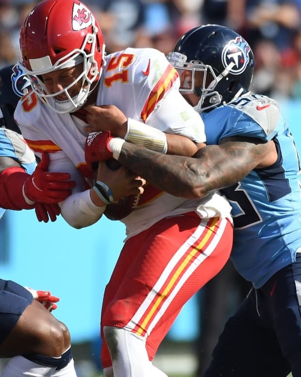 Kansas City Chiefs quarterback Patrick Mahomes (15) is sacked by Tennessee Titans outside linebacker Harold Landry (58) during the second half at Nissan Stadium.