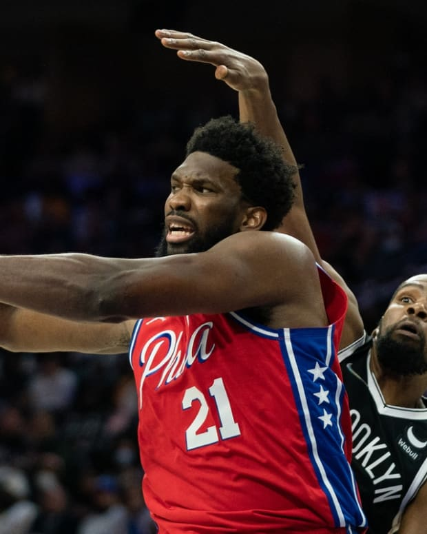 Oct 22, 2021; Philadelphia, Pennsylvania, USA; Philadelphia 76ers center Joel Embiid (21) passes the ball in front of Brooklyn Nets forward Kevin Durant (7) during the fourth quarter at Wells Fargo Center. Mandatory Credit: Bill Streicher-USA TODAY Sports