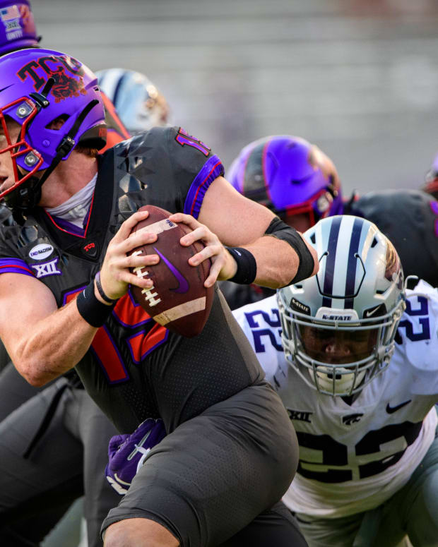 Oct 10, 2020; Fort Worth, Texas, USA; TCU Horned Frogs quarterback Max Duggan (15) eludes the Kansas State Wildcats rush during the second half at Amon G. Carter Stadium.