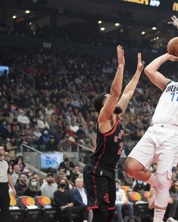 Oct 23, 2021; Toronto, Ontario, CAN; Dallas Mavericks guard Luka Doncic (77) drives to the basket as Toronto Raptors guard Fred VanVleet (23) and Toronto Raptors forward OG Anunoby (3) try to defend during the first quarter at Scotiabank Arena. Mandatory Credit: Nick Turchiaro-USA TODAY Sports