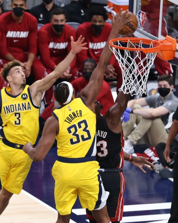 Oct 23, 2021; Indianapolis, Indiana, USA; Indiana Pacers center Myles Turner (33) blocks a shot by Miami Heat center Bam Adebayo (13) during the first half at Gainbridge Fieldhouse. Mandatory Credit: Robert Meyer-USA TODAY Sports