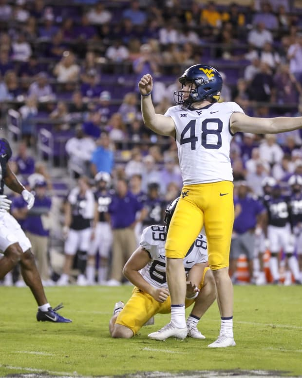 Oct 23, 2021; Fort Worth, Texas, USA; West Virginia Mountaineers place kicker Casey Legg (48) kicks a field goal during the second quarter against the TCU Horned Frogs at Amon G. Carter Stadium.