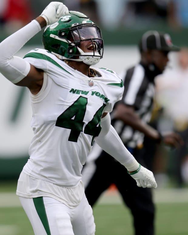 Jets linebacker Jamien Sherwood celebrates win