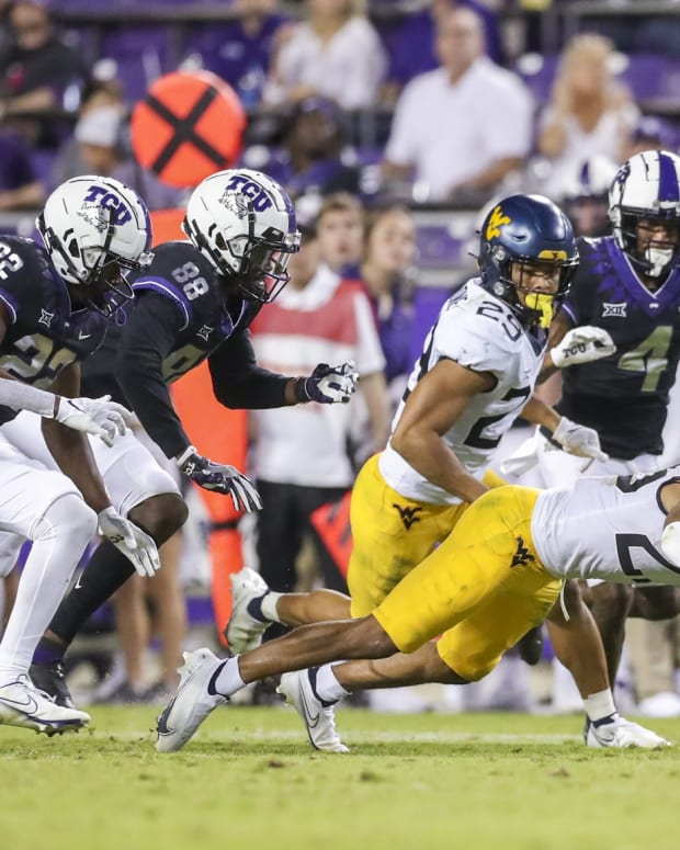 Oct 23, 2021; Fort Worth, Texas, USA; West Virginia Mountaineers defensive back Charles Woods (29) dives to recover a fumble during the fourth quarter against the TCU Horned Frogs at Amon G. Carter Stadium.
