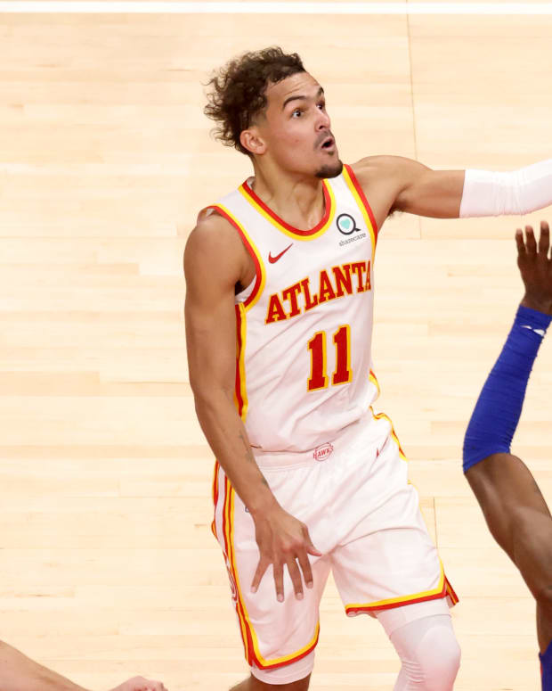 Atlanta Hawks point guard Trae Young (11) attempts a shot against Detroit Pistons forward Jerami Grant (9) during the second half at State Farm Arena.