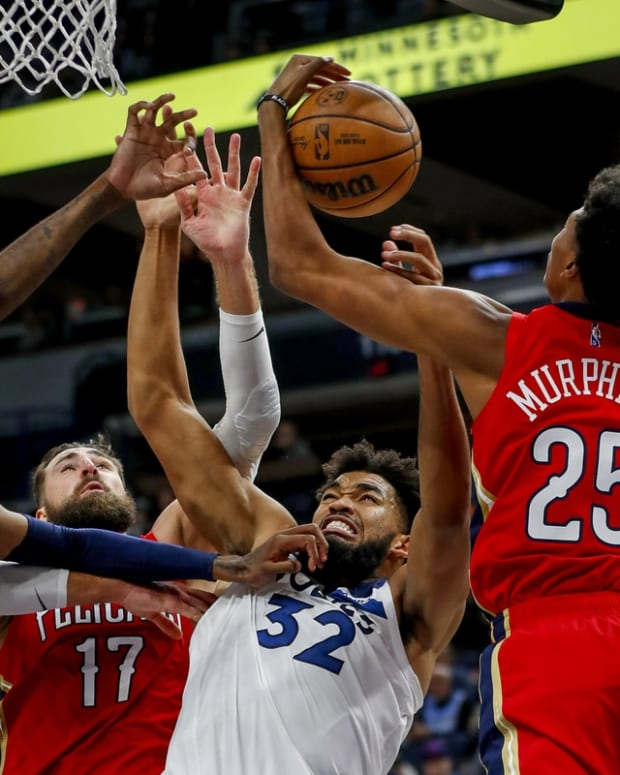 Oct 25, 2021; Minneapolis, Minnesota, USA; Minnesota Timberwolves forward Jaden McDaniels (3) and center Karl-Anthony Towns (32) battle with New Orleans Pelicans center Jonas Valanciunas (17) and forward Trey Murphy III (25) for a loose ball in the third quarter at Target Center. Mandatory Credit: Bruce Kluckhohn-USA TODAY Sports
