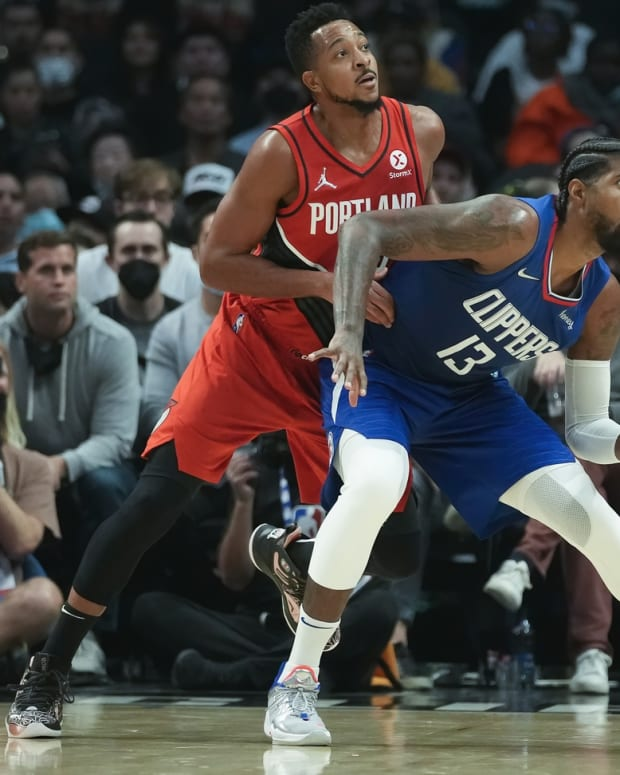 Oct 25, 2021; Los Angeles, California, USA; LA Clippers guard Paul George (13) and Portland Trail Blazers guard CJ McCollum (3) jockey for position on the baseline during the second quarter at Staples Center. Mandatory Credit: Robert Hanashiro-USA TODAY Sports