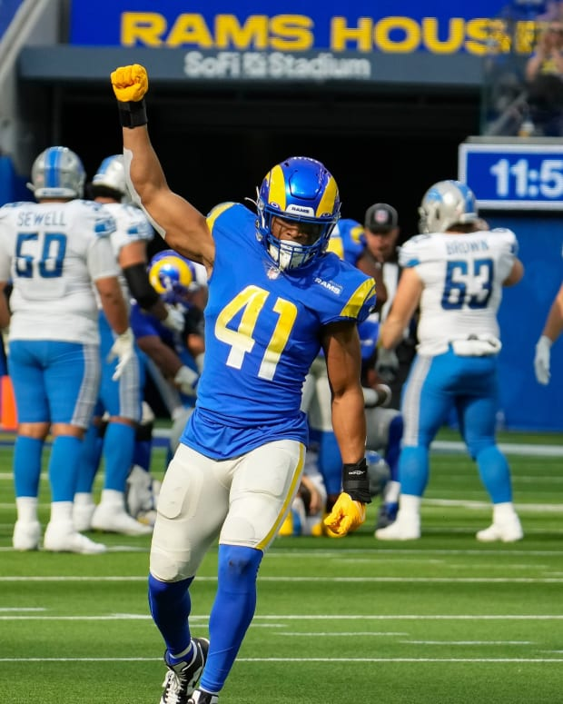 Los Angeles Rams inside linebacker Kenny Young (41) celebrates a third quarter sack of Detroit Lions quarterback Jared Goff (background) in the third quarter at SoFi Stadium.