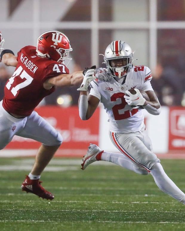 Micah McFadden tries to take down Ohio State's Evan Pryor.
