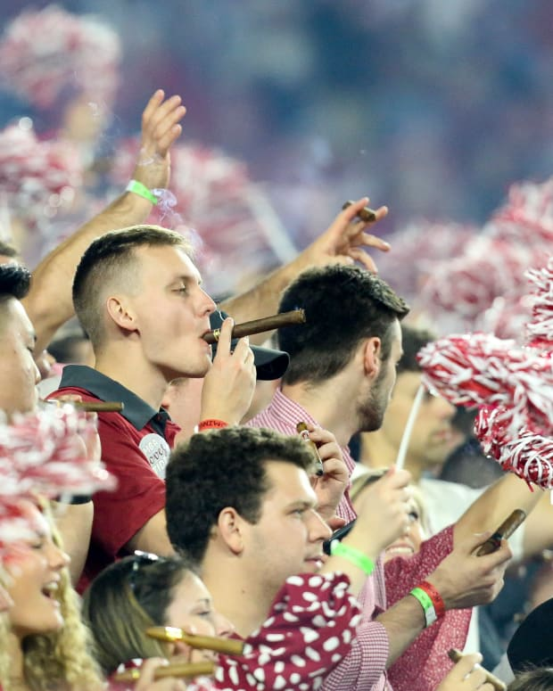 Oct 23, 2021; Tuscaloosa, Alabama, USA; Alabama Crimson Tide fans celebrate with the traditional postgame cigar after a victory over the Tennessee Volunteers at Bryant-Denny Stadium. Alabama won 52-24.
