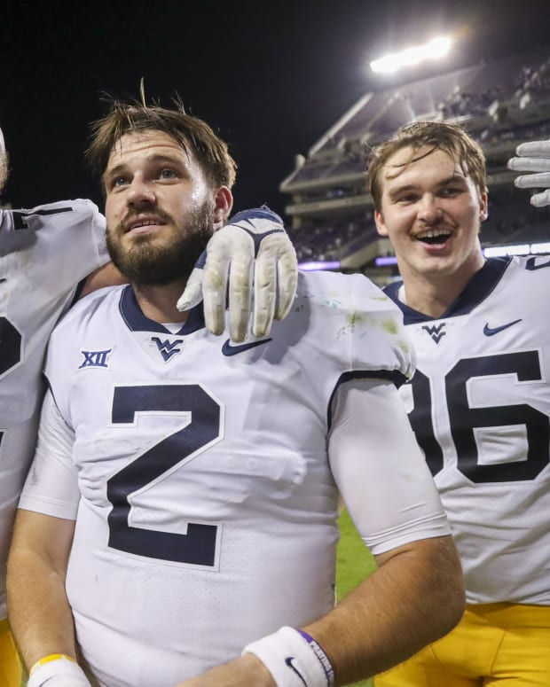 Oct 23, 2021; Fort Worth, Texas, USA; West Virginia Mountaineers offensive lineman Doug Nester (72) celebrates with West Virginia Mountaineers quarterback Jarret Doege (2) after defeating the TCU Horned Frogs at Amon G. Carter Stadium.
