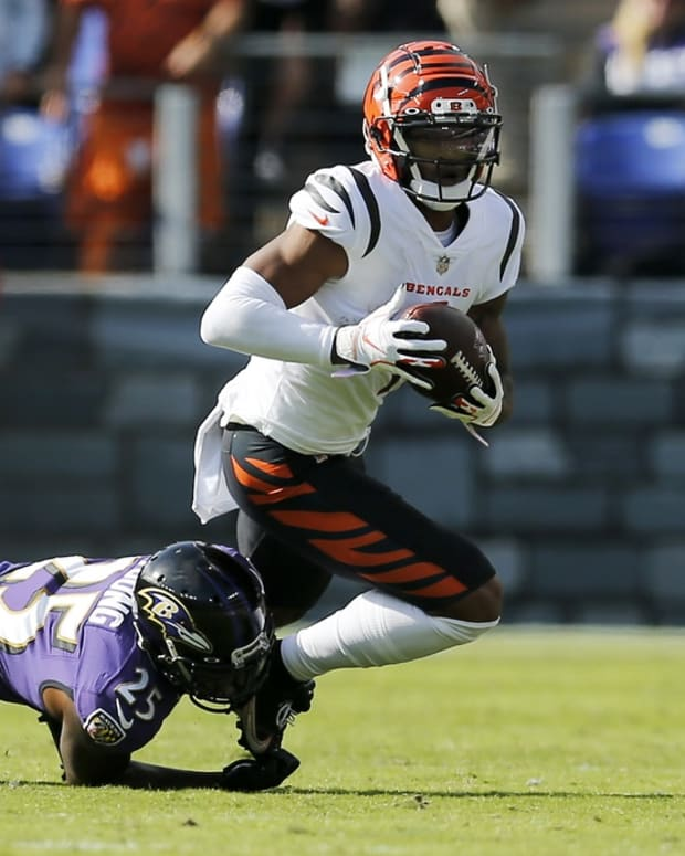 Oct 24, 2021; Baltimore, MD, USA; Cincinnati Bengals wide receiver Ja'Marr Chase (1) turns with a catch in the second quarter of the NFL Week 7 game between the Baltimore Ravens and the Cincinnati Bengals at M&T Bank Stadium in Baltimore on Sunday, Oct. 24, 2021. Mandatory Credit: Sam Greene-USA TODAY Sports