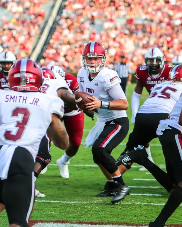 Oct 2, 2021; Columbia, South Carolina, USA; Troy Trojans quarterback Taylor Powell (7) looks to hand off to running back B.J. Smith (3) in the second quarter against the South Carolina Gamecocks Williams-Brice Stadium. Mandatory Credit: Jeff Blake-USA TODAY Sports