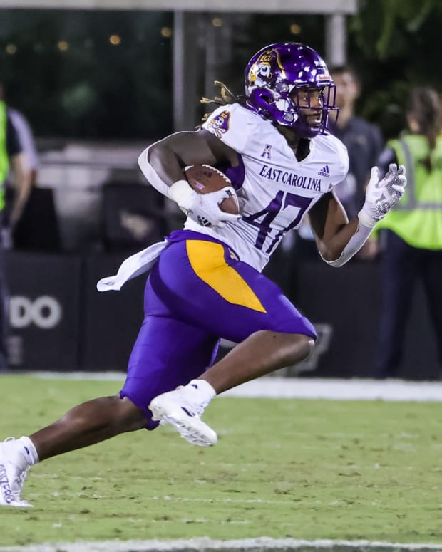 Oct 9, 2021; Orlando, Florida, USA; East Carolina Pirates running back Rahjai Harris (47) runs the ball during the second half against the UCF Knights at Bounce House. Mandatory Credit: Mike Watters-USA TODAY Sports