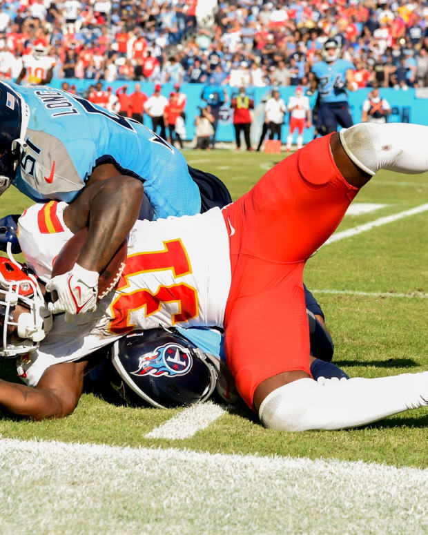 Kansas City Chiefs running back Darrel Williams (31) is stopped by Tennessee Titans linebacker David Long (51) during the fourth quarter at Nissan Stadium Sunday, Oct. 24, 2021 in Nashville, Tenn.