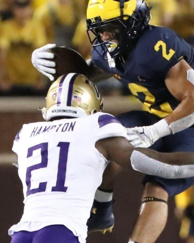 Dom Hampton tackles a Michigan wide receiver.