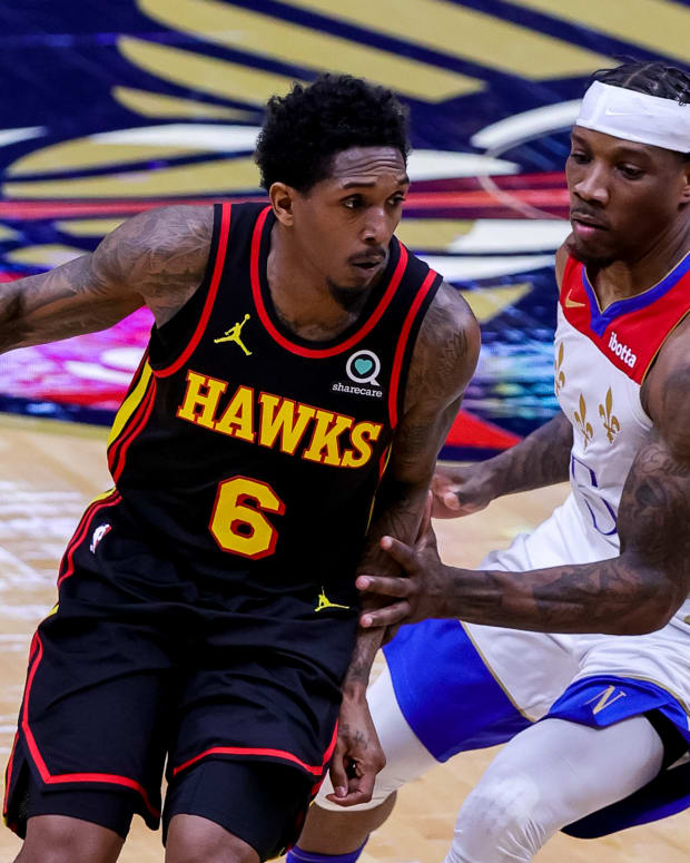 Atlanta Hawks guard Lou Williams (6) dribbles around New Orleans Pelicans guard Eric Bledsoe (5) during the first half at the Smoothie King Center.