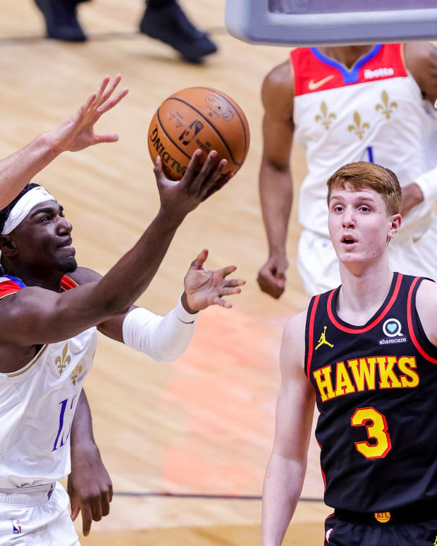 Atlanta Hawks guard Bogdan Bogdanovic (13) blocks the lay up attempt pt by New Orleans Pelicans guard Kira Lewis Jr. (13) during the second half at the Smoothie King Center.