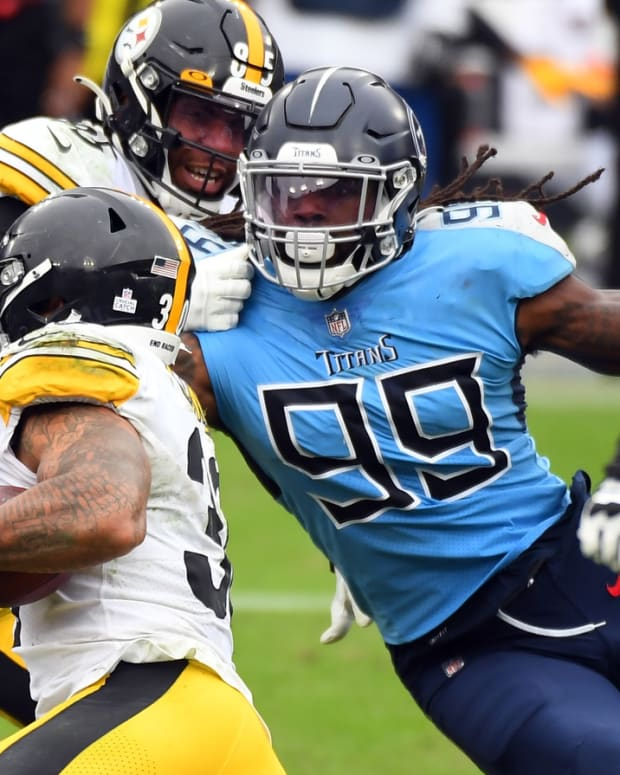 Oct 25, 2020; Nashville, Tennessee, USA; Tennessee Titans outside linebacker Jadeveon Clowney (99) tackles Pittsburgh Steelers running back James Conner (30) at Nissan Stadium. Mandatory Credit: Christopher Hanewinckel-USA TODAY Sports
