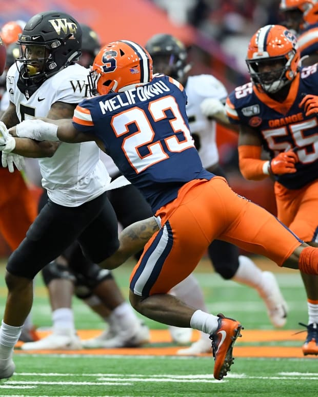 Nov 30, 2019; Syracuse, NY, USA; Syracuse Orange defensive back Ifeatu Melifonwu (23) breaks up a pass intended for Wake Forest Demon Deacons wide receiver Steven Claude (5) during the third quarter at the Carrier Dome. Mandatory Credit: Rich Barnes-USA TODAY Sports