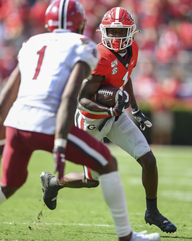 Georgia Bulldogs wide receiver George Pickens (1) runs against South Carolina Gamecocks defensive back Jaycee Horn (1) during the second half at Sanford Stadium.