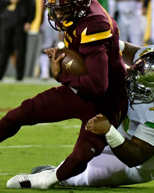 Sep 23, 2017; Tempe, AZ, USA; Arizona State Sun Devils quarterback Manny Wilkins (5) is tackled by Oregon Ducks defensive lineman Jordon Scott (34) during the first half at Sun Devil Stadium. Mandatory Credit: Matt Kartozian-USA TODAY Sports