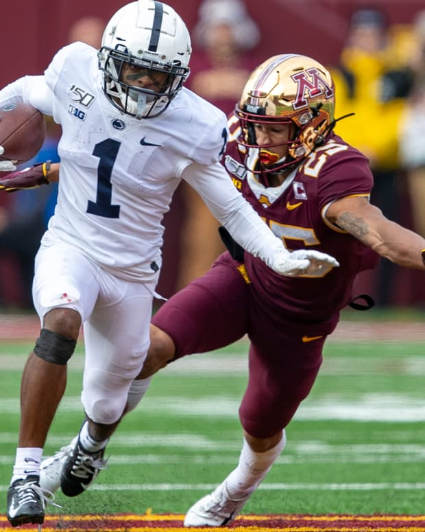 Nov 9, 2019; Minneapolis, MN, USA; Penn State Nittany Lions wide receiver KJ Hamler (1) rushes with the ball after making a catch as Minnesota Golden Gophers defensive back Benjamin St-Juste (25) attempts to make a tackle in the first half at TCF Bank Stadium. Mandatory Credit: Jesse Johnson-USA TODAY Sports