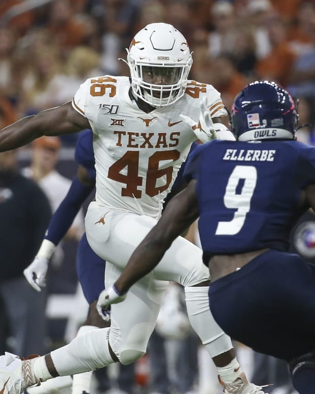 Sep 14, 2019; Houston, TX, USA; Texas Longhorns linebacker Joseph Ossai (46) attempts to make a tackle as Rice Owls running back Nahshon Ellerbe (9) runs with the ball during the second quarter at NRG Stadium. Mandatory Credit: Troy Taormina-USA TODAY Sports