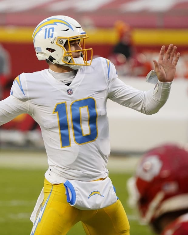 Jan 3, 2021; Kansas City, Missouri, USA; Los Angeles Chargers quarterback Justin Herbert (10) throws a pass against the Kansas City Chiefs during the first half at Arrowhead Stadium. Mandatory Credit: Jay Biggerstaff-USA TODAY Sports
