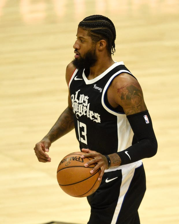 Mar 27, 2021; Los Angeles, California, USA; LA Clippers guard Paul George (13) takes the ball down the court during the first half against the Philadelpha 76ers at Staples Center. Mandatory Credit: Kelvin Kuo-USA TODAY Sports