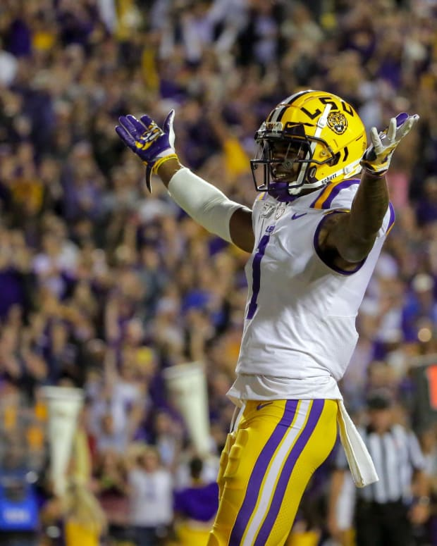 Oct 12, 2019; Baton Rouge, LA, USA; LSU Tigers wide receiver Ja'Marr Chase (1) celebrates after a touchdown catch against the Florida Gators during the first quarter at Tiger Stadium. Mandatory Credit: Derick E. Hingle-USA TODAY Sports