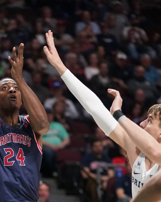 March 9, 2020; Las Vegas, NV, USA; Saint Mary's Gaels forward Malik Fitts (24) shoots the basketball against BYU Cougars guard Zac Seljaas (2) during the first half during the semifinal game in the WCC Basketball Championships at Orleans Arena. Mandatory Credit: Kyle Terada-USA TODAY Sports