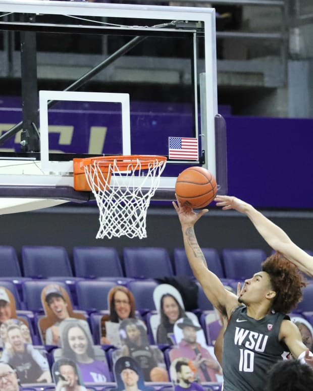 Erik Stevenson tries to block Isaac Bonton's shot for WSU.
