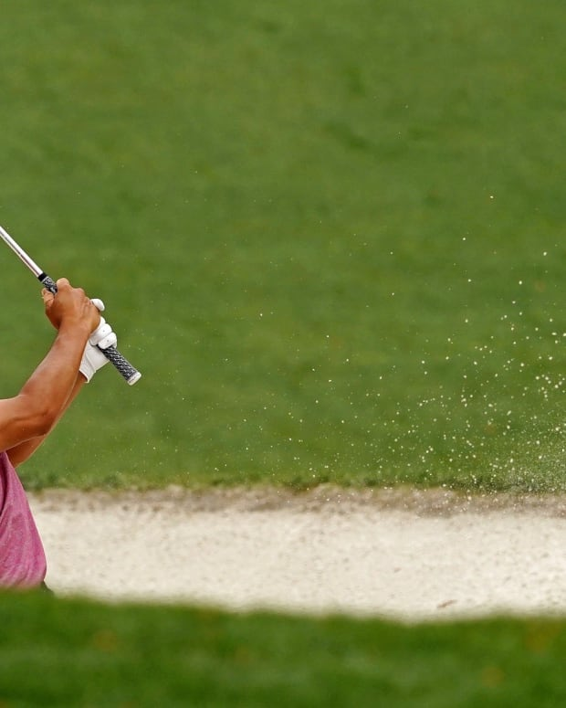 Collin Morikawa hits out of a bunker at the Masters