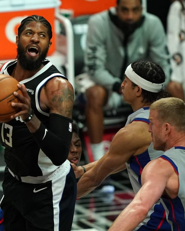 Apr 11, 2021; Los Angeles, California, USA; LA Clippers guard Paul George (13) shoots the ball against Detroit Pistons center Mason Plumlee (24) in the second half at Staples Center. Mandatory Credit: Kirby Lee-USA TODAY Sports