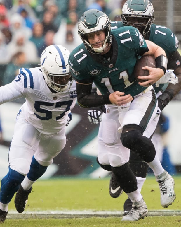 Sep 23, 2018; Philadelphia, PA, USA; Philadelphia Eagles quarterback Carson Wentz (11) runs with the ball as Indianapolis Colts defensive end Kemoko Turay (57) pursues during the second quarter at Lincoln Financial Field. Mandatory Credit: Bill Streicher-USA TODAY Sports