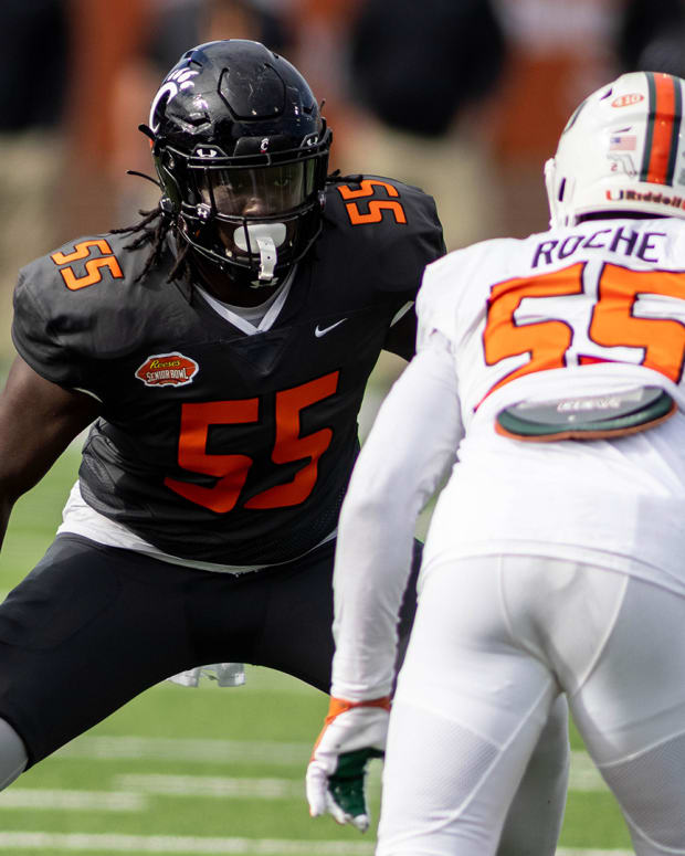 Jan 30, 2021; Mobile, AL, USA; National offensive lineman James Hudson III of Cincinnati (55) faces off against American defensive lineman Quincy Roche of Miami (55) in the first half of the 2021 Senior Bowl at Hancock Whitney Stadium. Mandatory Credit: Vasha Hunt-USA TODAY Sports