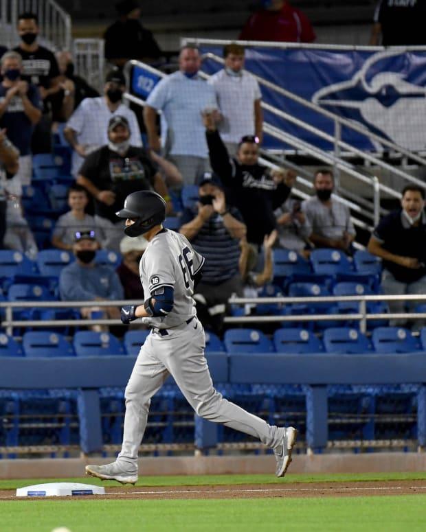 Kyle Higashioka running bases home run